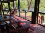 Large screened in back porch with a view of the river