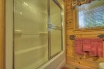 Lower Level Den with a Flat Screen TV, Gas-Log Fireplace and a Wet Bar with a Mini Fridge