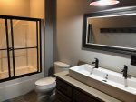 Lower level bathroom with a tub shower combo