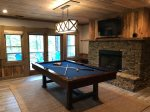 Game Room has a Pool Table, Gas - Log Fireplace with a Flat Screen TV