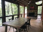 Main Floor Screen Porch Sitting Area with a Wood Buring Fire Place Fire Logs Only