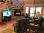 Living Room with a Gas-Log Fireplace and a Flat Screen TV