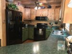Kitchen with Electric Appliances and Bar Seating For 2
