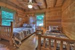 Master Bedroom with a King Bed, Flat Screen TV and a Private Screen Porch