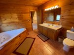 Loft Master Bathroom with a Shower Stall and Jetted Garden Tub
