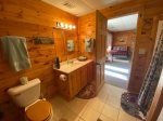 Lower level bathroom with a shower stall and the laundry room