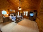 Open Loft Master Bedroom with a king bed, TV and a private screened porch