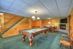 Game Room with a Flat Screen TV, Gas-Log Fireplace, Pool Table, Foosball Table and a Poker Table