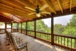 Main Floor Screened in Porch with 4 Rocking Chairs
