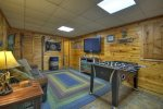 Den in the basement with a Sleeper Sofa, flat screen TV and Foosball Table