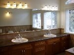 Huge Counter With Double Sinks And Heated Flooring In Master Suite