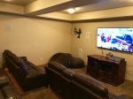 Lower Level - Theatre Room - 70 in. Flat Screen TV with Surround Sound and Platform Seating