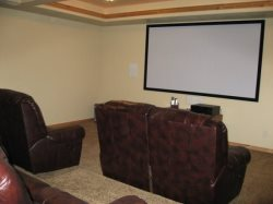 Downstairs - Theatre Room, 110 Screen, Front Projection System with 7 Channel Surround Sound.  Two Loveseats and Two Sofas