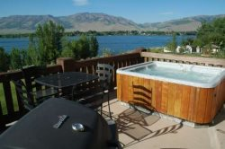 Private deck and hot tub with view of Pine View Reservoir