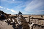 Oceanfront home and decks feature expansive views of Haystack Rock and the Pacific