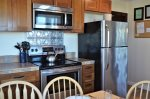The kitchen includes stainless steel appliances