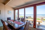 Spacious dining area with views of the Pacific and Haystack Rock