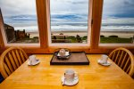 The kitchen table is a perfect spot to enjoy views of the Pacific