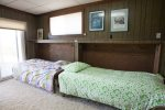 Bunk room with twin fold-down beds