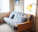 Futon in living room expands your sleeping options