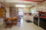 Charming, retro kitchen is perfect for meal prep and dining