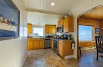 Full, remodeled kitchen with view