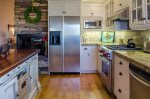 Full kitchen with stanless steel refrigerator
