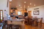 Large breakfast bar surrounds the eat in kitchen