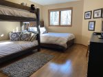 Third bedroom with bunks and queen bed
