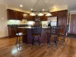 MH153 Fully equipped kitchen with modern appliances, granite counter tops, breakfast bar, and more