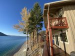 Amazing views of Whitefish Lake from the deck of this 3 bedroom lakefront home