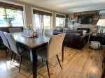 Open living, dining and kitchen area with fabulous lake views
