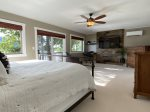 Master bedroom has a queen bed and sliding doors to the deck with lake views