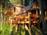 Enjoy this charming log cabin with large deck and BBQ overlooking the water