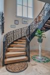 Up the beautiful custom wrought iron stairway to your suite