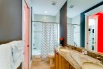 Bathroom with shower/tub combo.