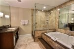 Master ensuite with spa tub and glassed shower