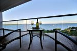 Relax on your private patio with a glass of wine at sunset