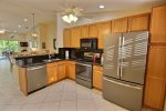 Lovely granite topped oak cabinetry and stainless appliances