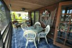 Screened porch runs length of house, canal side