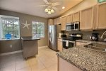 Open kitchen floor plan allows the cook to socialize too