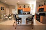 Fully equipped kitchen with breakfast nook area