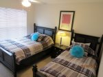 Bedroom with one full and one twin bed