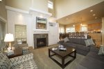 Cozy fireplace, sofas, chairs and with 32 inch LCD TV with Blu Ray DVD