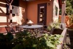 Outdoor living space with fire pit, gas barbeque, seated dining for four, fully fenced