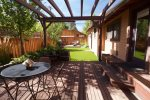 Fenced backyard with patio, barbeque, chairs, fire pit bring your firewood