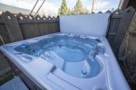 Private hot tub in fenced backyard, pet friendly dog
