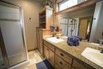 Master bath with granite tile counter tops, double sinks and walk in shower