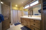 Jack and Jill bathroom shared by upstairs guest rooms with double sinks and shower/tub