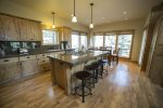 Granite countertops throughout kitchen with seating for 4 people at breakfast bar